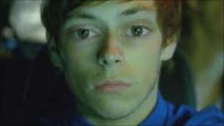 Image from drug driving advert of a boy with enlarged eyes