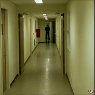 Corridor with guard at Yarl's Wood detention centre in Bedford