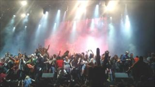 Fans invade the stage during M.I.A's headline act at the Big Chill