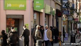 People queue outside branch of Job Centre Plus