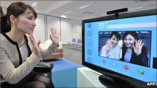 People using Skype (posed by models)