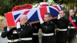 The coffin being carried from St John's Church