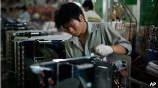 Worker on a production line of air conditioners at a factory in Zhuhai in south China's Guangdong province