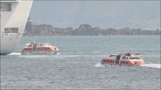 Liberty boats taking passengers from the cruise ship the Crown Princess to and from Guernsey's St Peter Port Harbour