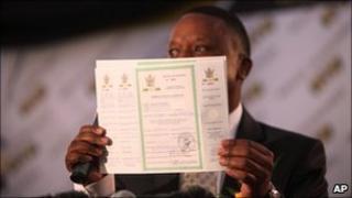 Abbey Chikane of Kimberley Process shows the certificate awarded to Zimbabwe
