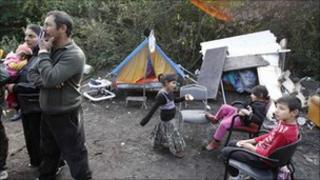 A Roma family stand in their illegal camp in Lesquin, near Lille