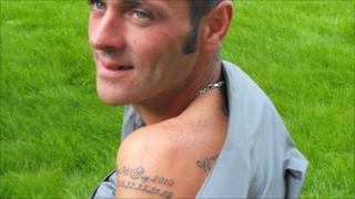 Wayne Hughes with the tattoo showing the date and numbers of his lottery win