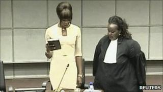 Naomi Campbell (left) is sworn in at The Hague, 5 August (video grab)
