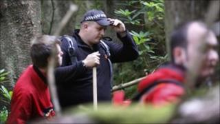 searchers in Argyll Forest
