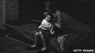 Mother and child take shelter from bombing in London in 1940
