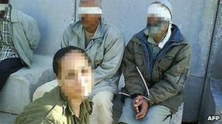 Eden Aberjil posing with Palestinian prisoners