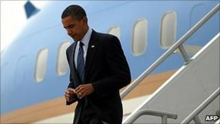 Barack Obama exits Air Force One