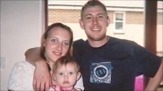 Sammy Betts and Michael Bishton with their daughter