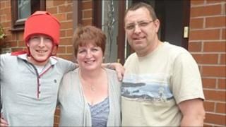 Thomas Buckett and his parents, Mandy and Andrew