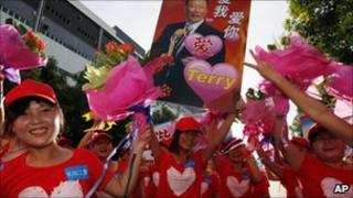 Foxconn workers carrying poster with the picture of company founder Terry Gou during a rally in Shenzhen, China, 18 August 2010