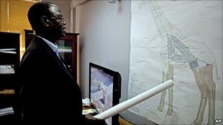 Daniel Wani, Undersecretary for the Ministry of Housing and Physical Planning in the Government of South Sudan, explains a map of Wau in the shape of an giraffe - 18 August 2010