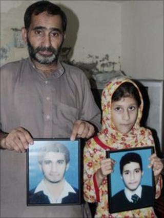 The portraits of the two brothers are shown by their father Sajjad Butt and sister Momina Butt at their home in Sialkot on Sunday, 22 August, 2010