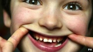 child showing his teeth