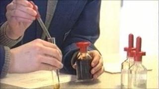 students doing scientific experiment