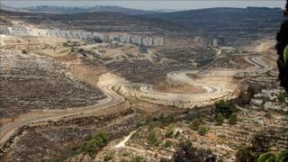 Agan Ha'ayalot settlement, with the West Bank barrier below (photo: Martin Asser)