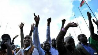 Kenyans cheer after an announcement of provisional results of Kenya's constitutional referendum in Nairobi