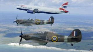 A Hurricane and Spitfire fly alongside an Airbus passenger jet as part of the Battle of Britain 70th anniversary celebrations