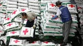 South Korean workers load fertilizer onto a ship in June 2006
