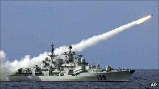 A Chinese ship launches a missile during a military exercise in the South China Sea on 29 July 2010