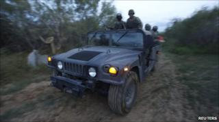 Mexican soldiers patrol a road after a gunfight with drug gang members near Monterrey. Photo: 2 September 2010