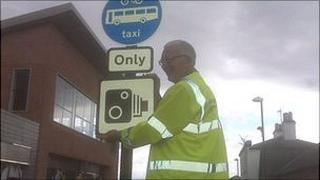 Councillor Stan Waddington with CCTV warning sign