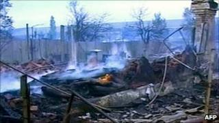 Russian NTV pictures of a house burned out by forest fire in the Volgograd region