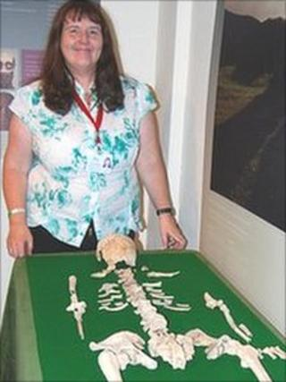 Shirley Williams with the skeleton of the Neolithic woman nicknamed Blodwen