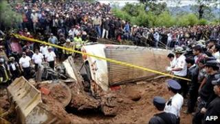 Guatemalan bus smashed by landslide surrounded by rescuers