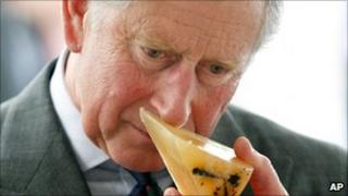 Prince Charles sniffs some environmentally-friendly soap