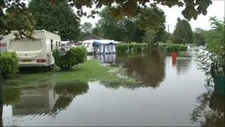 Part of a caravan park is underwater after the Colebrooke River burst its banks