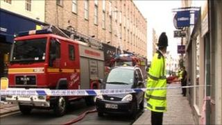 Police and fire service outside New Look in St Helier