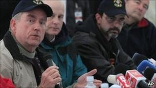 Dr Michael Duncan (left) and other Nasa experts speak during a news conference in Houston