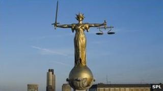 Statue of the Scales of Justice on the rooftop of the Old Bailey building