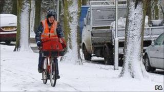 Postman on his bicycle