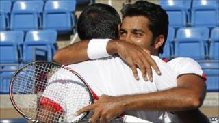 Rohan Bopanna of India, left, and partner Aisam-Ul-Haq Qureshi of Pakistan embrace after winning their semi-finals doubles match during the US Open tennis tournament in New York, Wednesday, 8 September 2010