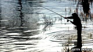 generic pic of angler fishing for salmon