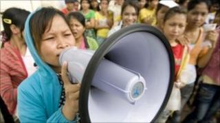 A worker shouts into a speaker on Phnom Penh on 13 September 2010