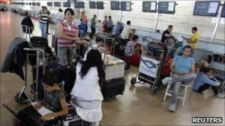 Passengers wait at Ben-Gurion airport, 13 September