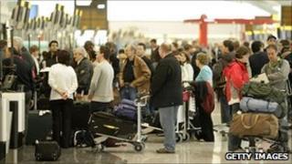 Tourists queue at Heathrow airport