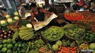A vegetable seller in a market in Kolkata