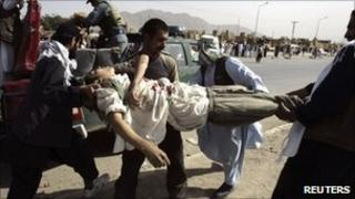 A man injured at the Kabul protest is helped - 15 September 2010