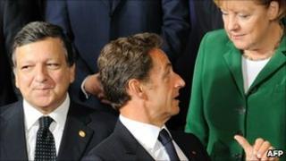 EU Commission President Jose Manuel Barroso (left), French President Nicolas Sarkozy, German Chancellor Angela Merkel