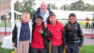 Lauren Nelson, 10, with Jerry Hirst (head teacher of Sacred Heart school in the city of Leicester), Rivaldo Remedios, 10, Jerin James, 10, Krystian Klonowski, 10