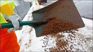 A council worker spreading salt (generic)