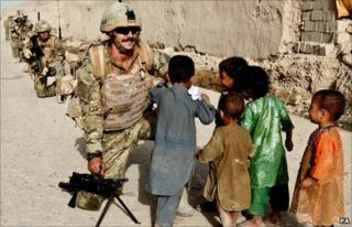 Ministry of Defence handout photo of a joint patrol of Royal Marines in Sangin